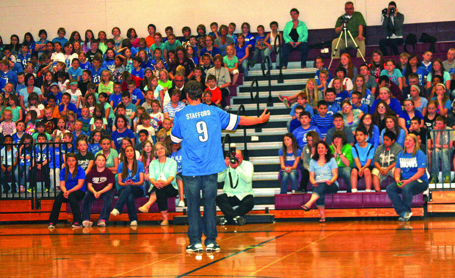 Detroit Lions quarterback Matthew Stafford addresses more than 500 students Tuesday at Cass City Elementary School during a promotional visit.    Photo: Dave Shane/Huron Daily Tribune