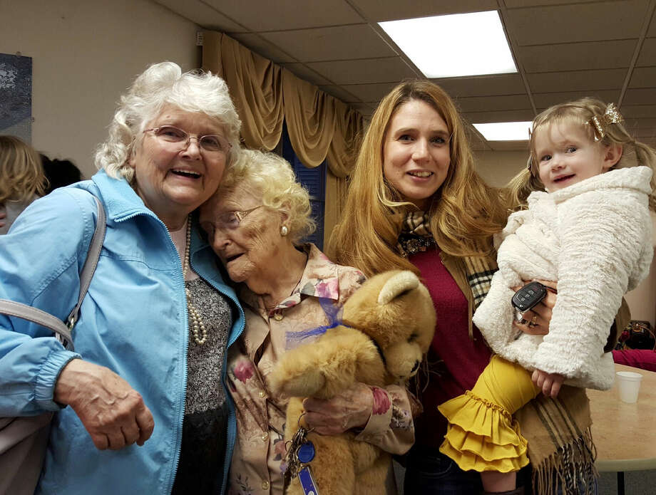 In a Jan. 15, 2016 photo provided by Kimberly Miccio, Betty Morrell, left, and her birthmother, Lena Pierce, 96, are reunited at the Greater Binghamton Airport. Morrell's granddaughter, Kimberly Miccio, holding her own daughter, accompanied Morrell to Binghamton from Spring Hill, Fla., where they both live. Morrell had searched for 50 years for Pierce, who at age 13 was forced to give up the baby she had named Eva May. (Kimberly Miccio via AP) Photo: Kimberly Miccio