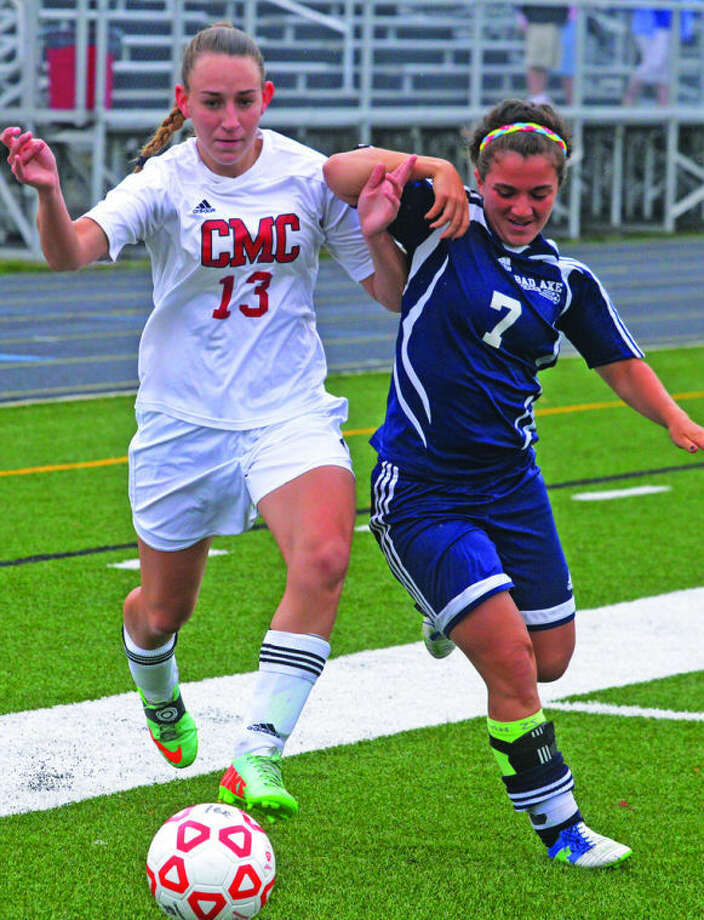 Bad Axe's Madison Kohler (7) and Cardinal Mooney's Savannah O'Neil (13) contend for a ball in the first half.