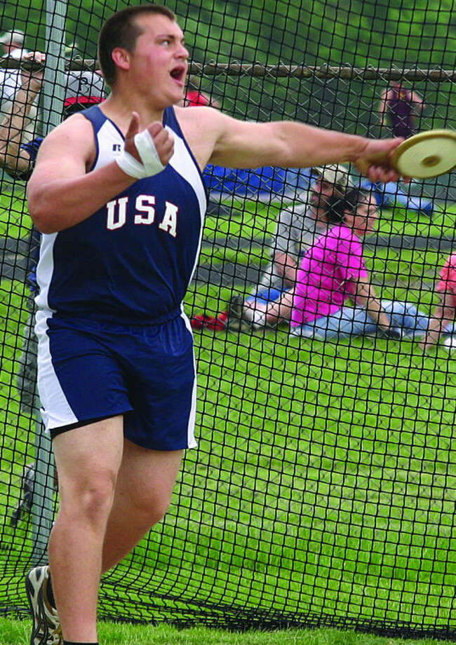 Photo courtesy of Tuscola County AdvertiserUSA's Tucker Scharf is shown here throwing the disc at the Thumb Meet of Champions. The senior won the Division 4 discus state championship, Saturday.