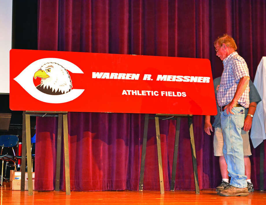 Casey Johnson/Huron Daily TribuneBuilding and Grounds Supervisor Warren Meissner is surprised to see the Caseville athletic fields named in his honor during a ceremony Wednesday at the school.