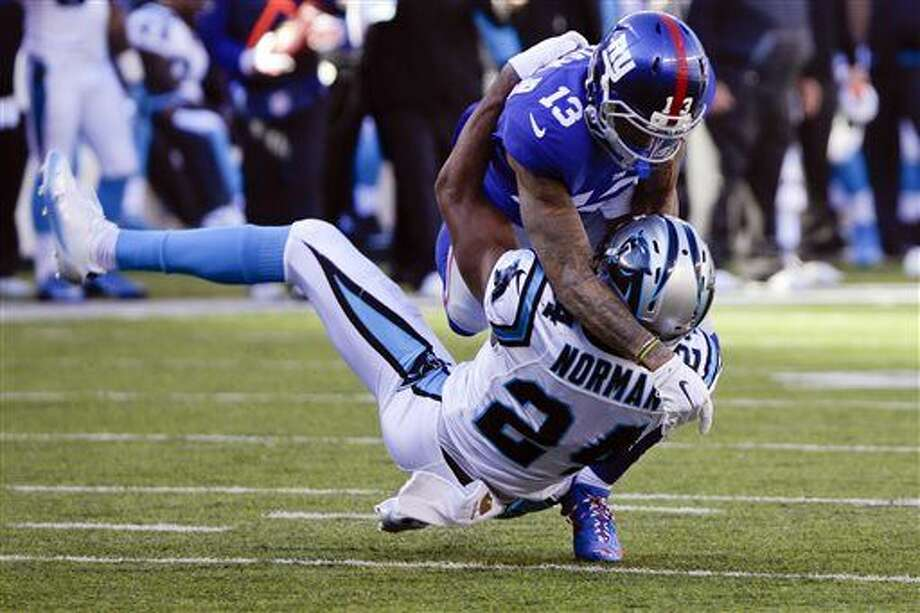 In this Dec. 20, 2015, file phoo, New York Giants wide receiver Odell Beckham (13) and Carolina Panthers' Josh Norman (24) grapple during the first half of an NFL football game in East Rutherford, N.J. In response to the season's violent outbursts by Giants receiver Odell Beckham Jr., Bengals linebacker Vontaze Burfict and others, NFL Commissioner Roger Goodell suggested a rule might be passed that would call for an automatic ejection if a player receives two personal fouls in a game. (AP Photo/Julie Jacobson, File)