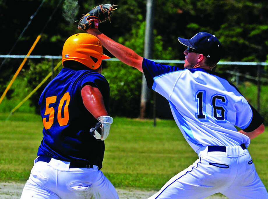 BCAS first baseman Nick Hunter (16) secures an out just before North Huron's Justin Hatch (50) could get to the bag in the Division 4 regional championship.