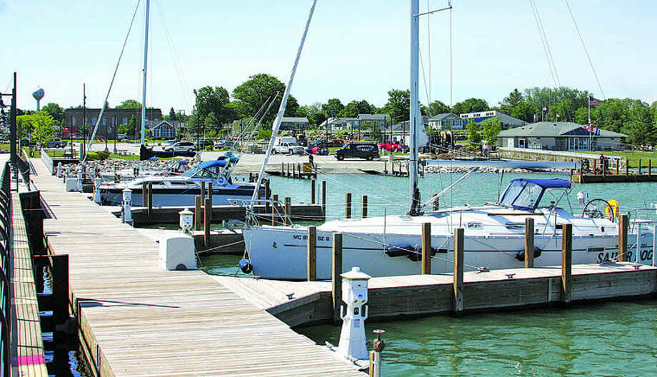 Boats take advantage of the new east docks Thursday morning at the Port Austin Harbor. Photo: Seth Stapleton/Huron Daily Tribune