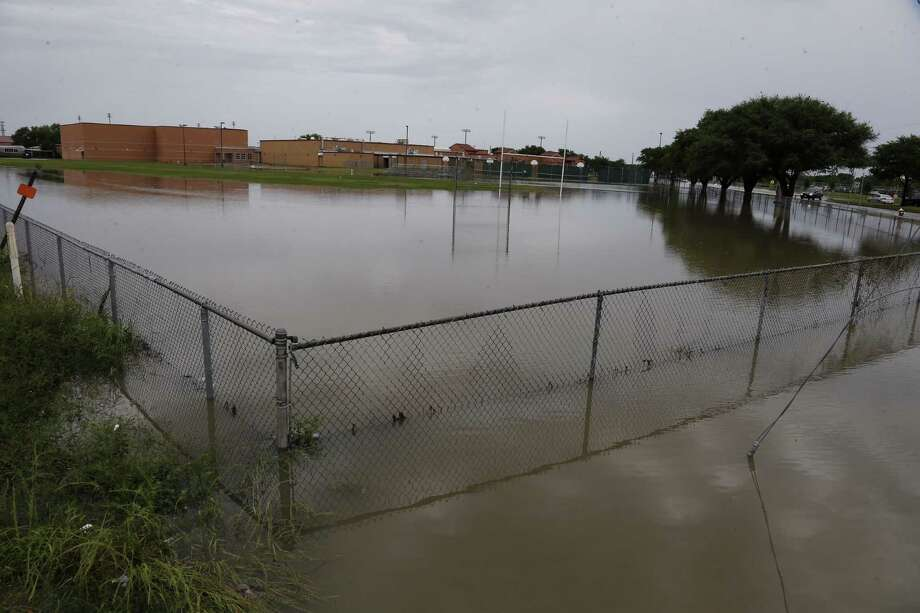 Flooding can be seen at Cypress-Fairbanks Independent School District's Arnold Middle School on April 20, 2016. Photo: James Nielson/Houston Chronicle