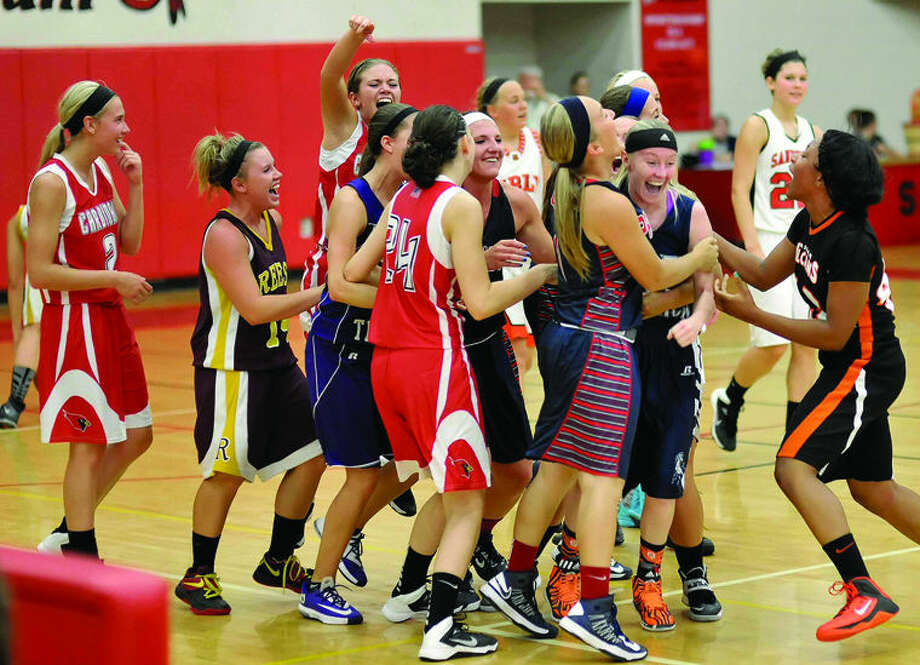 North Branch's Rachel Losey is mobbed by her All-Thumb All Star West teammates after hitting the game-winning three-pointer in overtime Friday in Sandusky. Photo: Photo Courtesy Of KG Photography