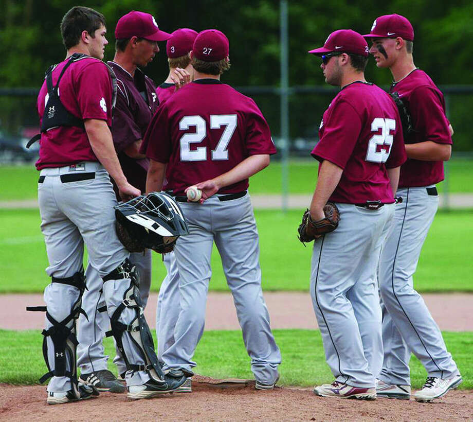 Cass City baseball coach Nathan Haag talks with his team during a 2013 district game at USA. Recently, Haag, along with longtime assistant Nathan Fritz stepped down from their posts to spend more time with their families.