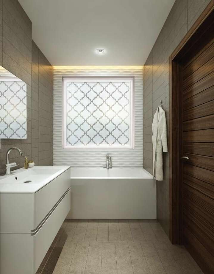 Elegant privacy windows and upgraded fixtures can enhance a bathroom.