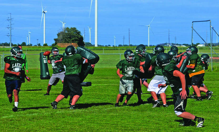 The EPBP varsity football team runs an offensive play during practice, Thursday afternoon at EPBP. The Lakers are coming off their first playoff appearance since 2009.