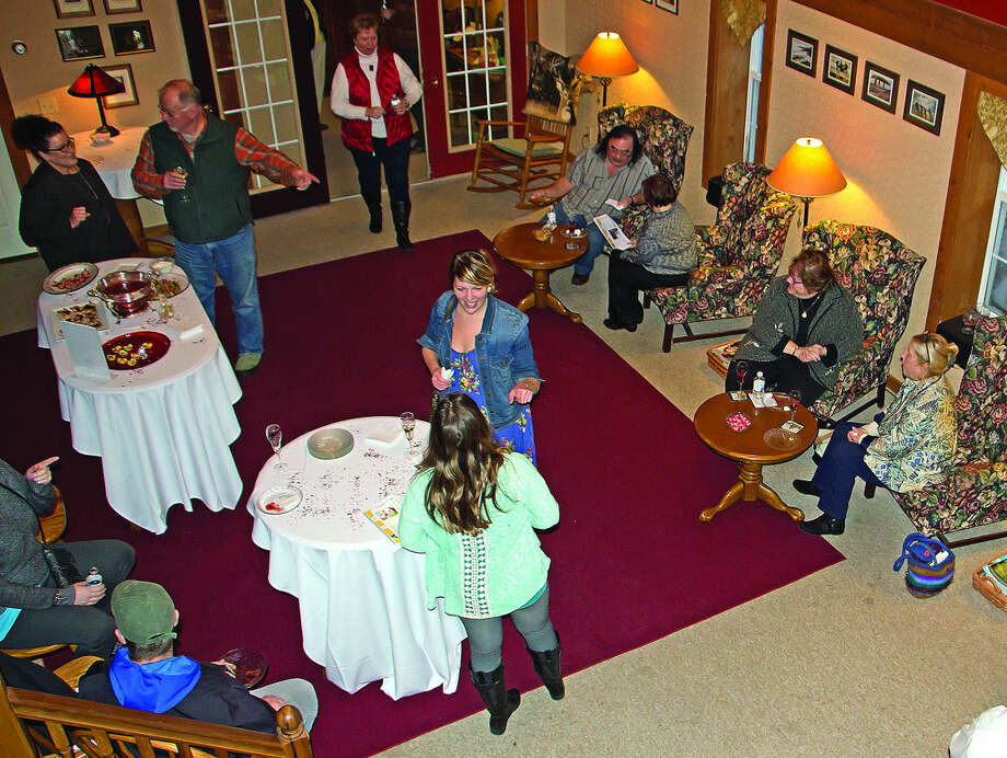 "Visitors gather to listen to music and enjoy light refreshments at a fundraiser for Homeless Solutions, called ""Have a Heart for the Homeless,"" recently at The Lodge at Oak Pointe, near Caseville. Photo: Bill Diller/For The Tribune"