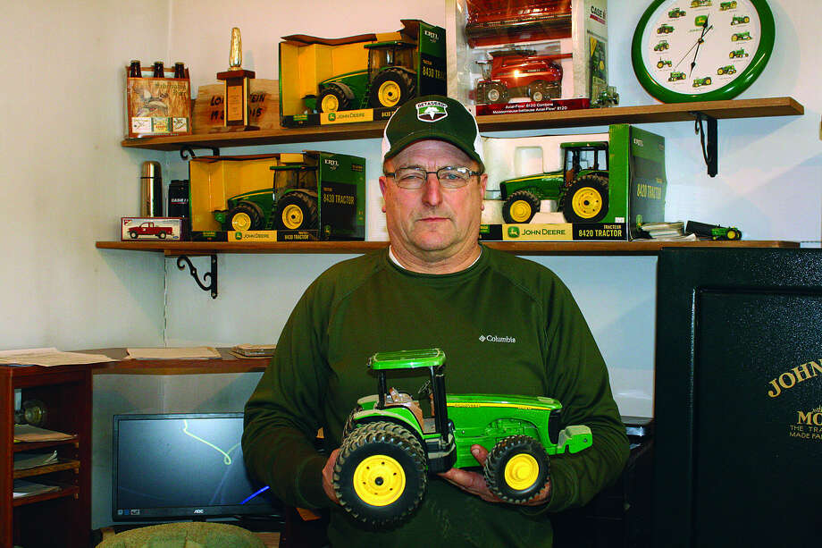 Much of Gruehn's farm equipment is John Deere, and the dealership would give him toy tractors when equipment was purchased. His grandson loves to play with this toy tractor whenever he visits the shop. Pat and his brother, Mark, are the fourth generation in their family to farm. Their sons, Dustin and Shaun, are now the fifth generation to continue in the business.