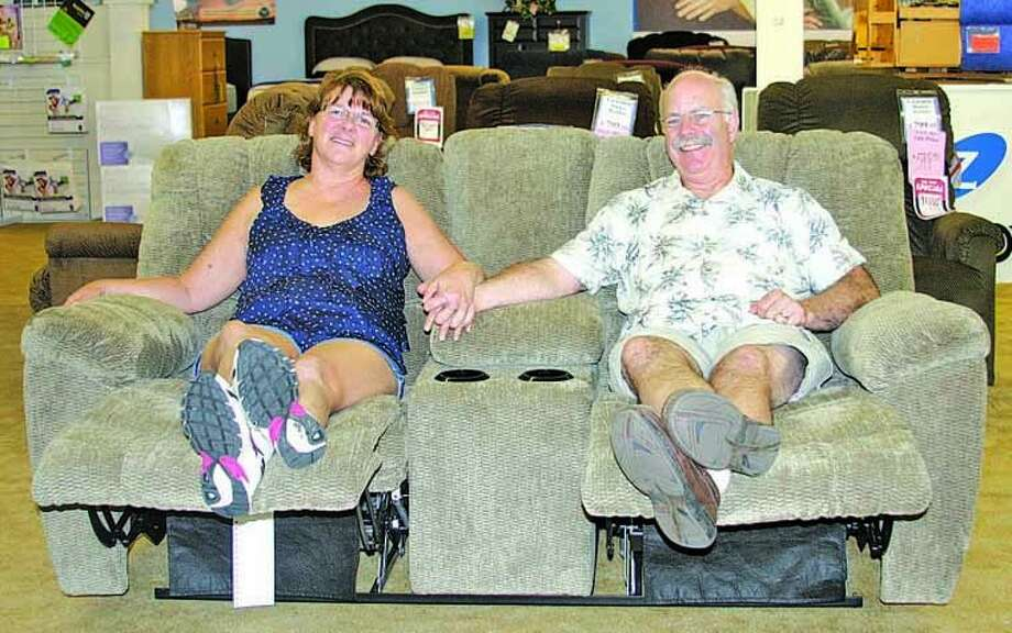 Kim and Ken Murray are retiring and their Murray's Mattresses and Home Furnishings store in Bad Axe has been sold to Godwin's Furniture and Mattress of Saginaw. Photo: Seth Stapleton/Huron Daily Tribune