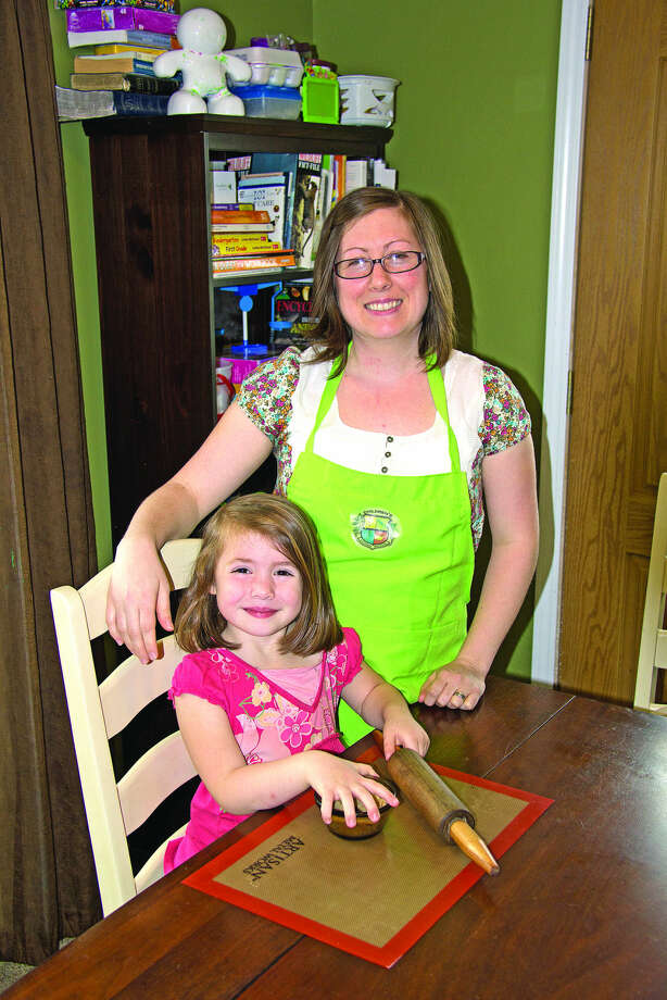 Olivia Mohr, 4, helped her mother, Shar Mohr, prepare a pie as part of her home-school curriculum. For more information on Country Kids Cooking School, contact Shar Mohr at sharmohr@gmail.com. Photo: Bill Diller/For The Tribune