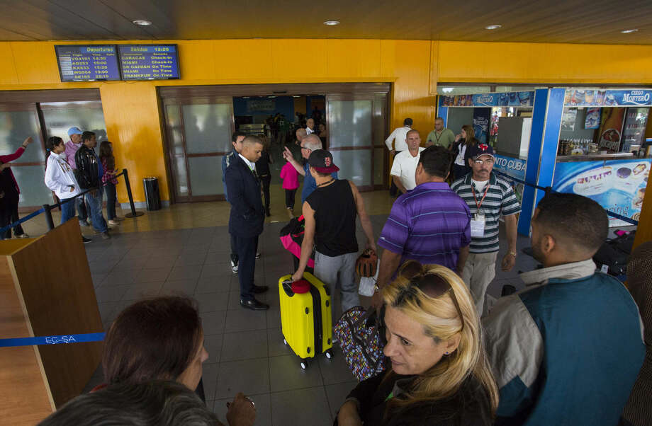 In this Wednesday, Feb. 10, 2016 photo passengers enter the charter departures terminal of the a Jose Marti International Airport in Havana, Cuba. The United States and Cuba have signed an agreement on Tuesday, Feb. 16, to resume commercial air traffic for the first time in five decades, starting the clock on dozens of new flights operating daily by next fall. (AP Photo/Desmond Boylan) Photo: Desmond Boylan