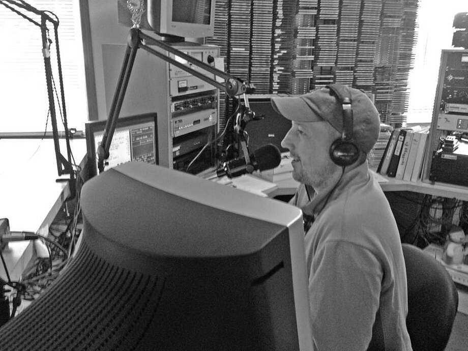Derek Bosley broadcasts from the Mix 92.1 studio. Folks can hear him from 7 a.m. to 2 p.m. Monday through Friday, as well as portions of Saturdays that include Let's Talk Sports, a segment that starts at 10 a.m. Photo: Kate Hessling/Huron Daily Tribune