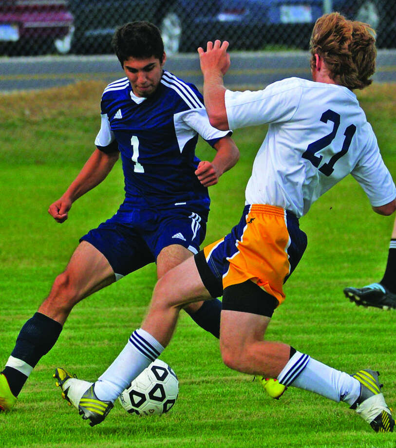USA's Marcus Largent (1) handles the ball in front of Bad Axe's Kyle Cregeur (21) during the first half of the Hatchet's 2-0 win, Thursday in Bad Axe.