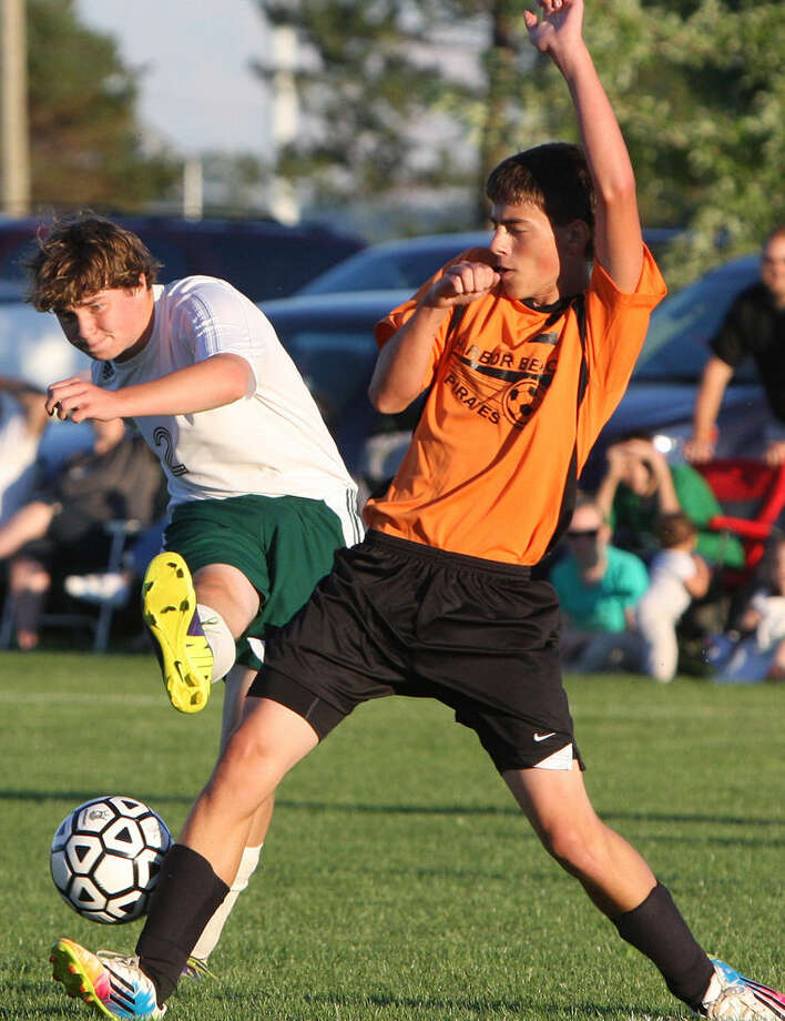 EPBP's Alex Nothelfer takes a shots against Harbor Beach's Thomas Roggenbuck during the first half of the Pirates' 3-1 victory, Tuesday at EPBP.