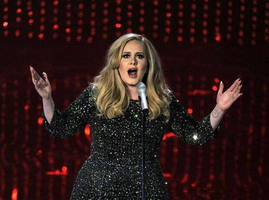 In this Feb. 24, 2013 file photo, singer Adele performs during the Oscars at the Dolby Theatre in Los Angeles. Adele is warming up for her upcoming concert tour with a special show for fans in Los Angeles on Friday. The singer announced Wednesday that she'll give a concert at The Wiltern concert venue on Friday, Feb. 12, 2016, three days before the Grammy Awards. To get in, fans in the California area need to be registered on her website, Adele.com. (Photo by Chris Pizzello/Invision/AP)