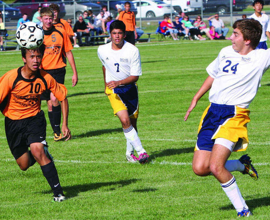 Harbor Beach's Robert Ocomen (10) and Bad Axe's Daniel Fucinari (24) chase after a loose ball during the first half of the Pirate's 4-0 victory, Monday in Bad Axe.