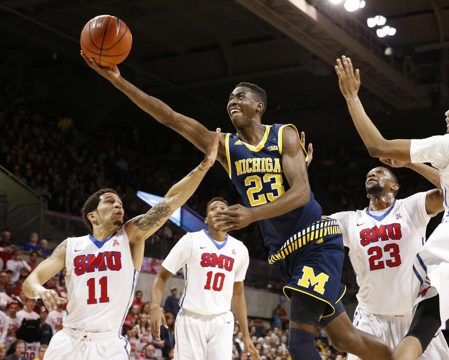 FILE - In this Dec. 8, 2015, file photo, Michigan guard Caris LeVert (23) shoots the ball in front of SMU guard Nic Moore (11) and guard Jarrey Foster (10) during the first half of an NCAA basketball gamein Dallas. (AP) Photo: Jim Cowsert