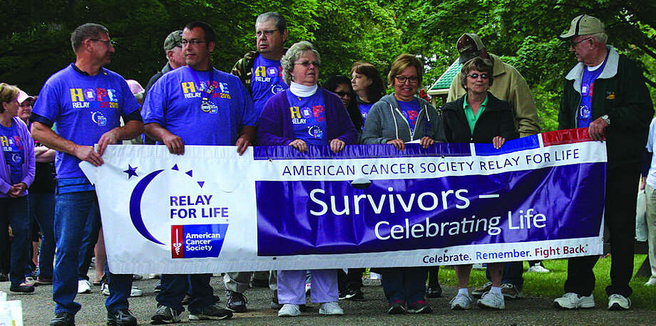 Survivors and supporters line up for the survivor lap Saturday. See Page 8A for more Relay for Life coverage.
