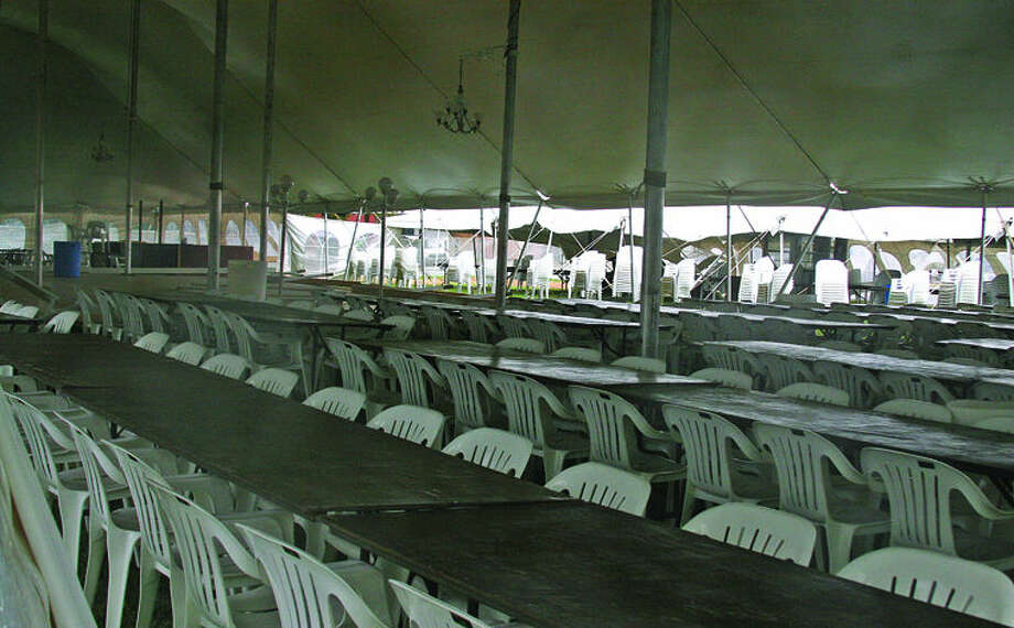 The tables, chairs and dance floor are all set up late Wednesday under the Polka Fest tent in Kinde. Photo: Casey Johnson/Huron Daily Tribune