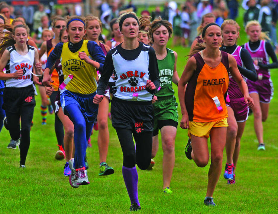 From left, Bad Axe's Mikayla Beeler, Ubly's Madison Brown, EPBP's Sadie Muntz and Deckerville's Kylee Colesa pace the field near the start of the Ubly Invitational, Thursday in Ubly.