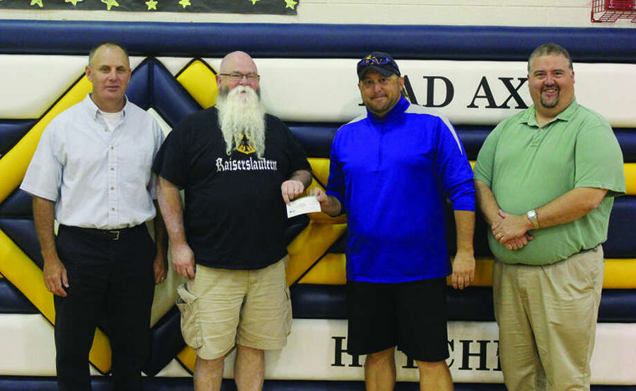 Sean McVey, Craig Harris, Mike Bogan, Greg Newland, representing the Friends of Bad Axe present a check to the Bad Axe athletic department.  Photo: Courtesy Photo
