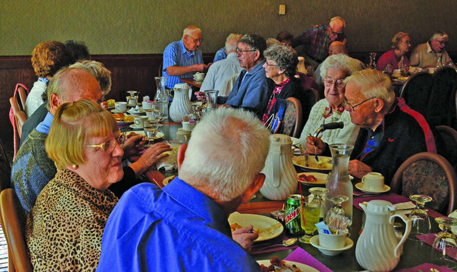Nearly 30 graduates from the Bad Axe High School classes of 1944 and 1946 gather at the Franklin Inn for a reunion.