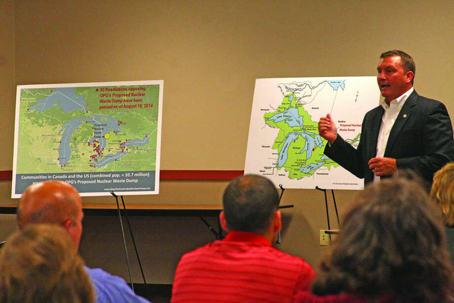 State Sen. Phil Pavlov of St. Clair Township addresses the audience Monday night at a townhall meeting in Sebewaing. The concern is plans for nuclear waste dump 55 miles east of Huron County near the shores of Lake Huron in Ontario. Photo: Chris Aldridge/Huron Daily Tribune