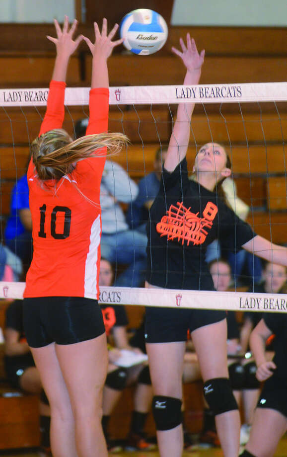 Harbor Beach's Grace Kozfkay (10) attempts to block a kill by Ubly's Melanie Puvalowski (8) during Game 1 of the Bearcats' win, Thursday in Ubly.