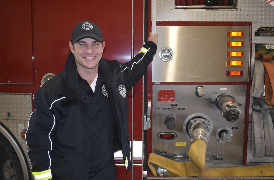 Clinton Township firefighter Ryan McCuen poses, Tuesday, Feb. 23, 2016 in Clinton Township, Mich. McCuen, a suburban Detroit firefighter, paid off a struggling family's electricity bill of more than $1,000 after responding to a call at their home. (Mitch Hotts\The Macomb Daily via AP) Photo: Mitch Hotts