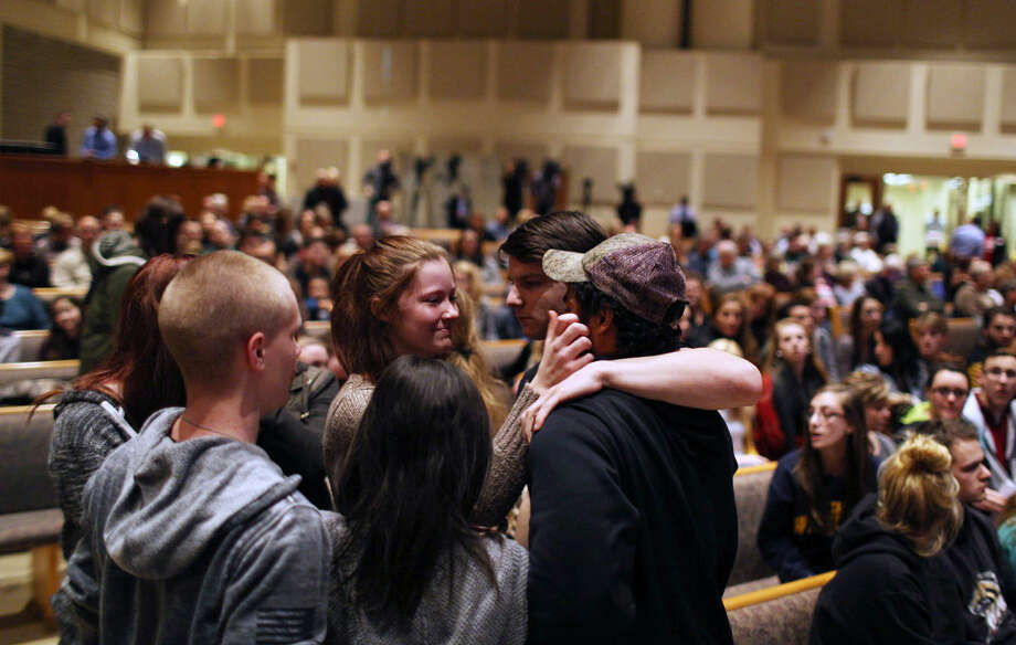 Members of the community pray before the start of the Kalamazoo Community Prayer Service at Centerpoint Church on in Kalamazoo, Mich., Sunday, Feb 21, 2016. A gunman who seemed to choose his victims at random opened fire Saturday outside an apartment complex, a car dealership and a restaurant in Michigan, killing six people in a rampage that lasted nearly seven hours, police said. (Andraya Croft/Detroit Free Press via AP) Photo: Andraya Croft