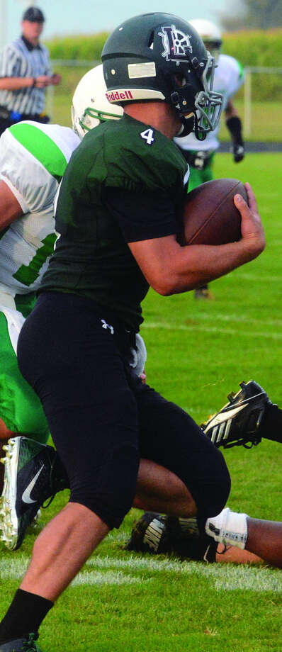 EPBP quarterback Dustin Kady gains yardage against Brown City, Sept. 5 at EPBP. Kady has battled injuries this season, but when on the field, has been a driving force for the Laker offense.