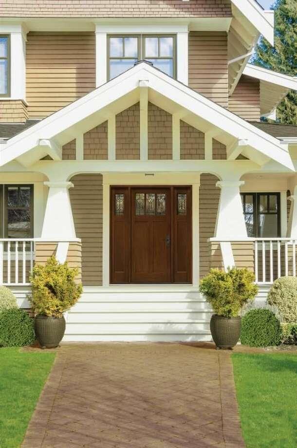 A fiberglass door with doorlites and sidelites creates a stunning entryway.