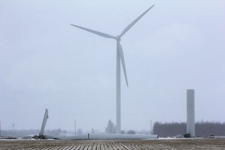 Trucks are at the scene Tuesday wherea nearly 400-foot, 485,000-pound turbine fell at a farm near Berne and Gagetown roads inOliver Township last week.  Photo: Chris Aldridge/Huron Daily Tribune