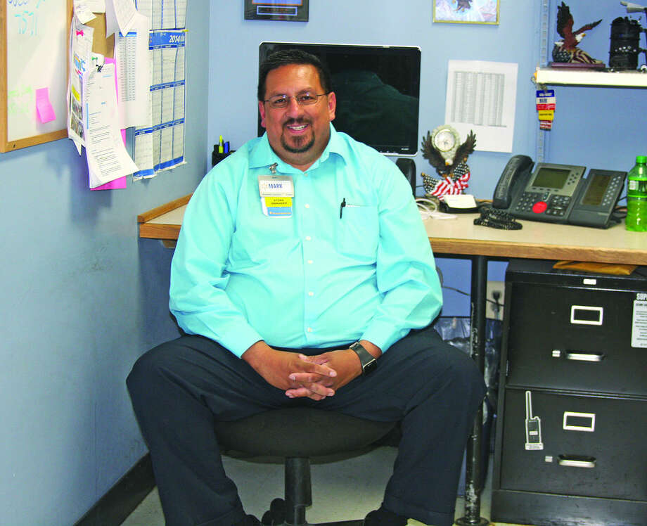 Mark Torres, the manager of the Wal-Mart store in Bad Axe, was once a high school dropout who had few friends and little chance for success. Photo: Brad Massman/Huron Daily Tribune