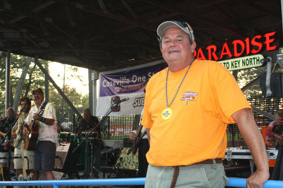 Steve Louwers, president of the Caseville Area Chamber of Commerce, is pictured in front of Air Margaritaville's performance at this year's Cheeseburger in Caseville Festival.