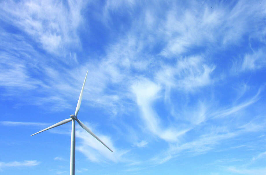 More wind turbines will be joining this one and filling the sky of Huron County, as plans call for 72 new turbines to give the county more than 400. That's at least twice as many as any other county in Michigan. Photo: Chris Aldridge/Tribune File Photo