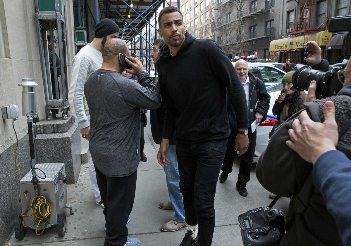 FILE - In this photo from Wednesday, April 8, 2015, Atlanta Hawks forward Thabo Sefolosha, center, leaves a courthouse in New York. Sefolosha plans to fight charges he blocked officers from setting up a crime scene following the stabbing of Indiana Pacers' Chris Copeland outside a trendy Manhattan nightclub in April. (AP Photo/Craig Ruttle, File)
