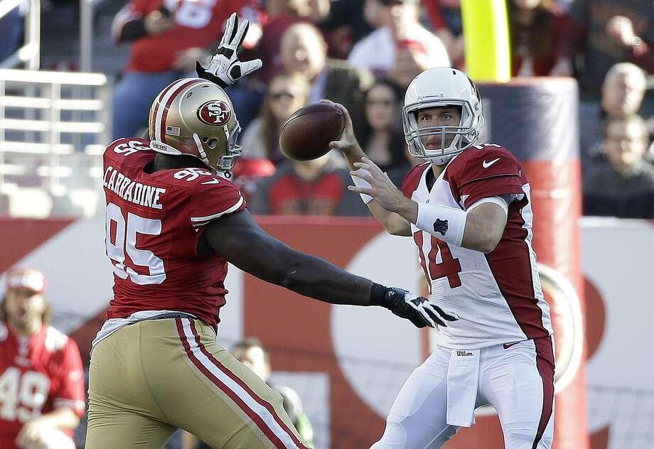 ef6770e44 Arizona Cardinals quarterback Ryan Lindley (14) passes as San Francisco  49ers defensive end Tank