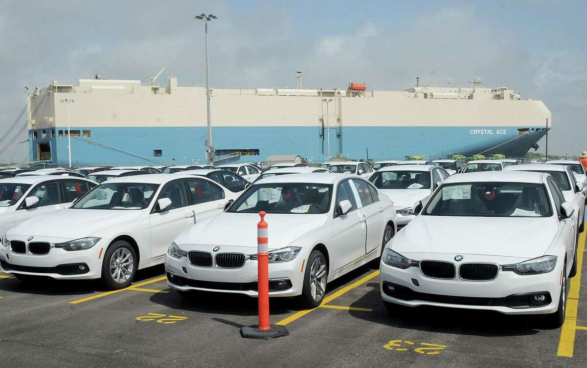 A transport delivering new vehicles is docked at the new BMW vehicle distribution center on Harborside Drive in Galveston.