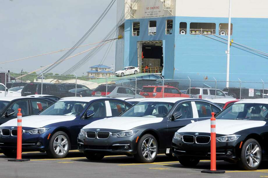 New vehicles roll out of a transport ship at the new BMW Vehicle Distribution Center on Harborside Drive in Galveston Wednesday April 20,2016(Dave Rossman Photo) Photo: Dave Rossman, Freelance / Dave Rossman