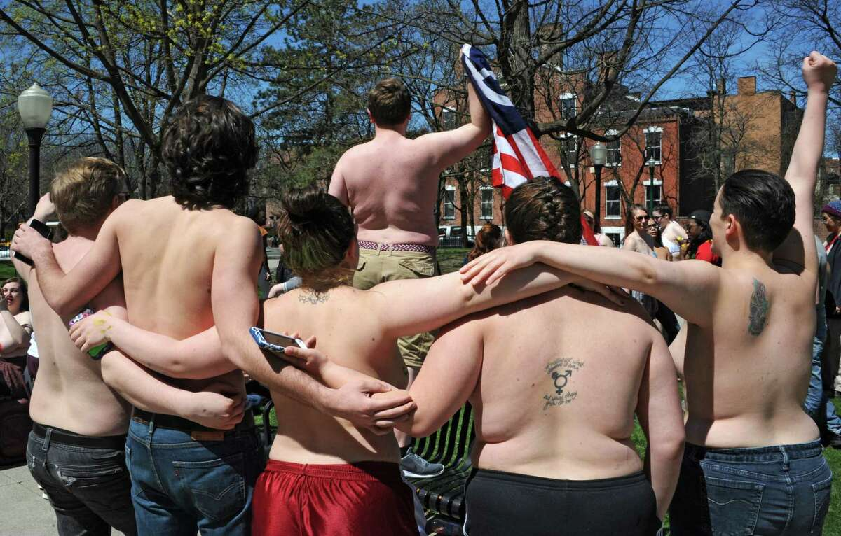 Sage students, upset by police treatment of Cedar Brock, who identifies as androgynous, hold a topless protest in Sage Park on the Russell Sage College campus Wednesday, April 120, 2016 in Troy, N.Y. A school security officer approached Cedar, who was sunbathing topless in a public park that fronts the campus. (Lori Van Buren / Times Union)