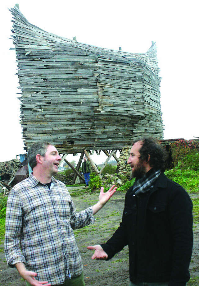 Jim Boyle (left) and artist Scott Hocking discuss the building of the mammoth art project near Oak Beach. Photo: Rich Harp/For The Tribune