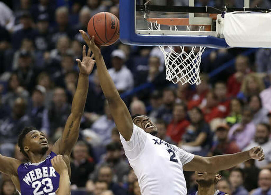 Xavier's James Farr (2) gets past Weber State's Richaud Gittens (23) to put up a shot during the first half of a first-round men's college basketball game in the NCAA Tournament, Friday, March 18, 2016, in St. Louis. (AP Photo/Charlie Riedel) Photo: Charlie Riedel