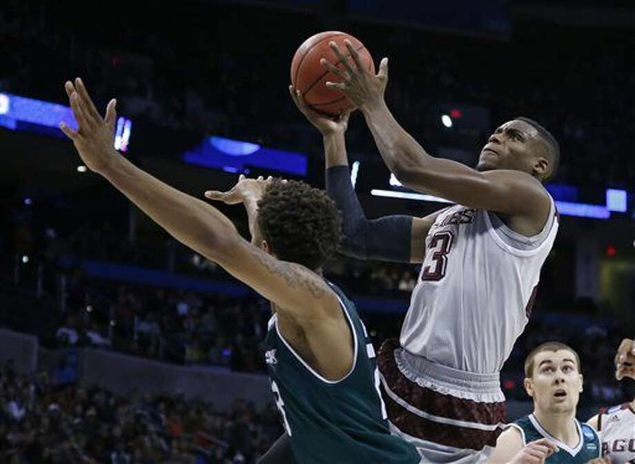Texas A&M guard Danuel House, right, shoots over Green Bay forward Jamar Hurdle, left, in the first half of a first-round men's college basketball game in the NCAA Tournament, Friday, March 18, 2016, in Oklahoma City. (AP Photo/Sue Ogrocki) Photo: Sue Ogrocki