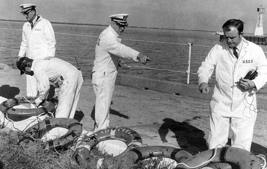 In a Nov. 24, 1975 file photo Coast Guard officers on a Board of Inquiry inspected life rings that were recovered from the ore carrier Edmund Fitzgerald, which sank in stormy weather in Lake Superior on Nov. 10, 1975. All 29 crewmen aboard perished and did not get a chance to use any of the lifesaving equipment. The Great Lakes have claimed some 6,000 ships since European explorers began navigating the waters in the 1600s, but few have captured the public's imagination as has the Edmund Fitzgerald. (AP Photo/GE, File) Photo: GE