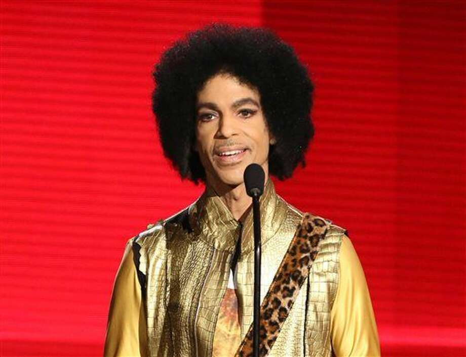 In this Nov. 22, 2015 file photo, Prince presents the award for favorite album - soul/R&B at the American Music Awards in Los Angeles. Authorities are investigating a death at Paisley Park, where pop superstar Prince has his recording studios. Jason Kamerud, Carver County chief sheriff's deputy, tells the Minneapolis Star Tribune that the investigation began on Thursday morning, April 21, 2016. (Photo by Matt Sayles/Invision/AP)