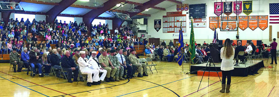 Many brave men and women, better known as veterans (seated left), were honored at Ubly Community Schools on Wednesday morning at its annual Veteran's Day program. The hour-long ceremony gave students an opportunity to thank the veterans for their service and sacrifice. Superintendent Rocky Aldrich recognized each veteran in attendance by reading their name, rank, military branch and where they served. Photo: Bradley Massman/Huron Daily Tribune